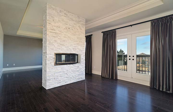 stacked white stone on fireplace wall Living room Pinterest